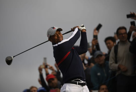 Tiger Woods plays a tee shot  during his fourball match Friday.