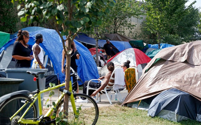 City leaders have been reluctant to break up what's believed to be the largest homeless camp ever seen in Minneapolis.