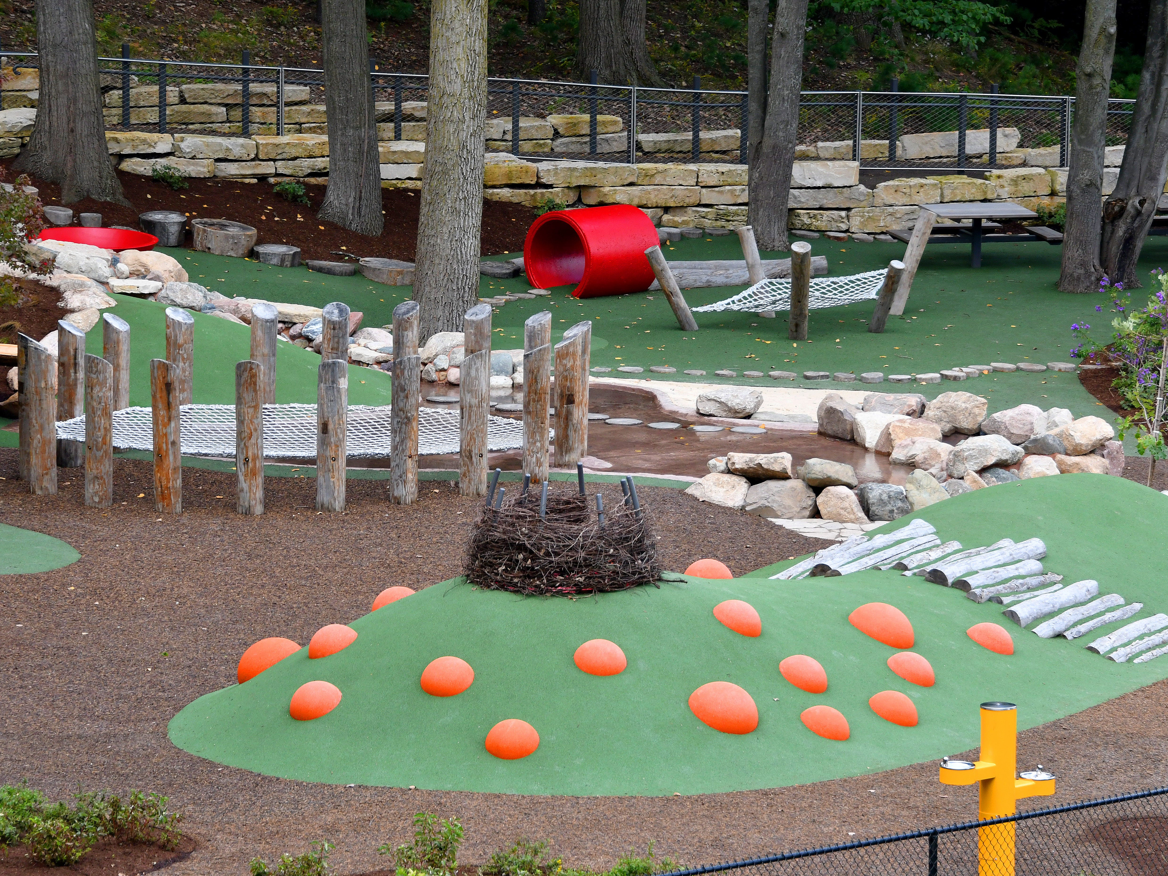 The play area includes picnic tables and is also conveniently located next to the cafe.