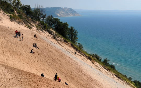 Visitors look out over Lake Michigan at Sleeping Bear National Lakeshore. In 2017, more than 1.6 million people stopped at the park, which includes 35 miles of shoreline.
