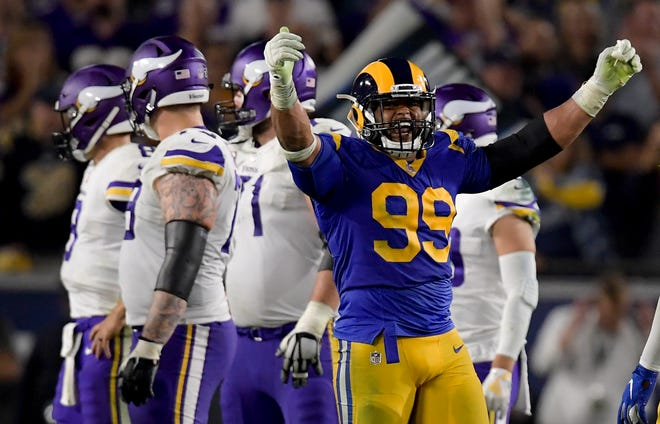 Los Angeles Rams defensive tackle Aaron Donald celebrates after sacking Minnesota Vikings quarterback Kirk Cousins during the second half on Thursday.