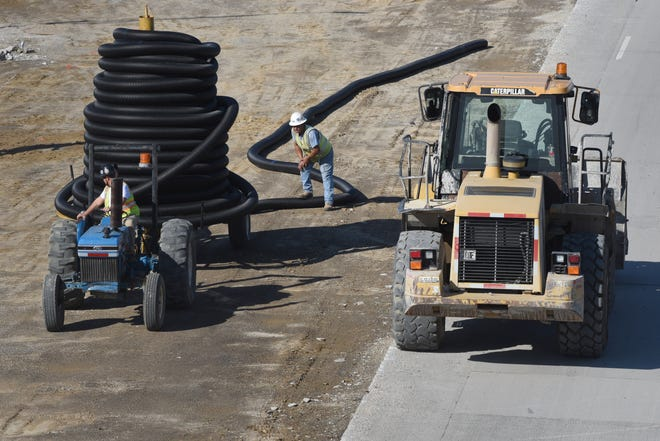 Road construction crews resume work at I-696 at Thomas Avenue in Warren on Friday.