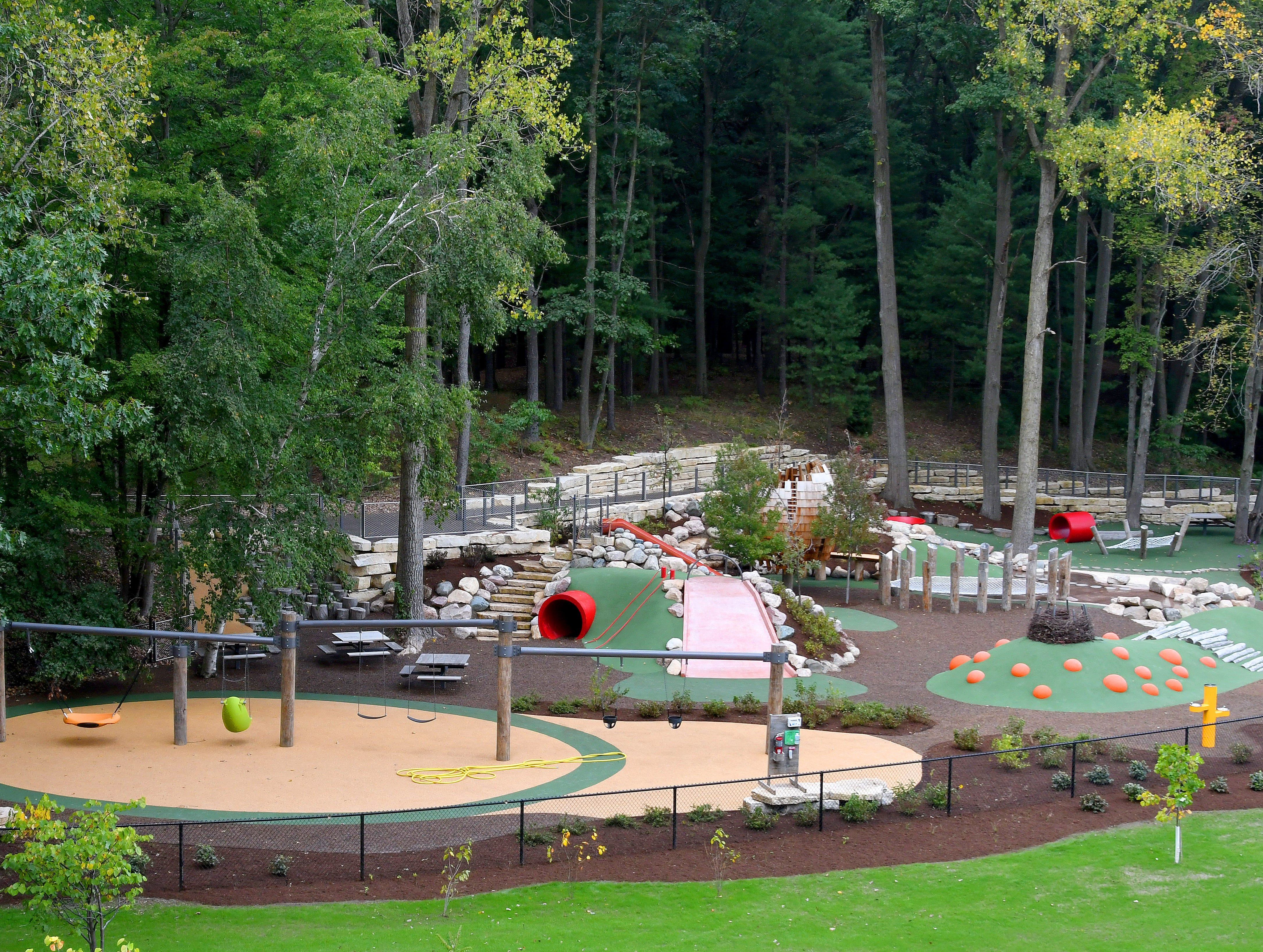 """The kids play area includes climbing and water adventures but is covered with soft landing areas to make it """"fall-friendly"""" in case somebody takes a tumble."""