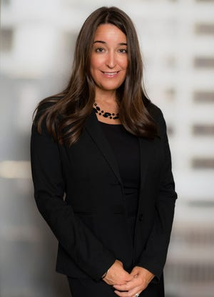 Angie Kelly takes over as the managing partner of Ernst & Young's Detroit office on Saturday.