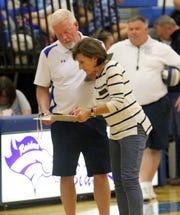 Tim Crout talks to Patti Perone during a Horseheads match against Corning on Sept. 27, 2018 at Horseheads Middle School.
