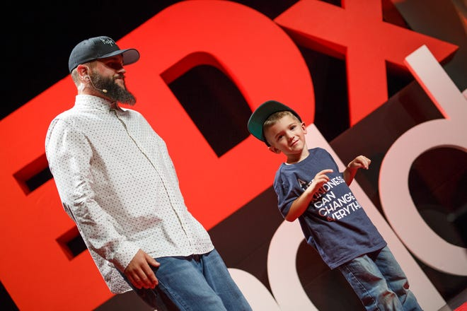 Nathan Scheer is joined onstage by his son Bentley, Saturday, August 25, 2018, during his Tedx talk at the Thelma Sadoff Center for the Arts in Fond du Lac, Wisconsin. Photo courtsey of Brian Kolstad