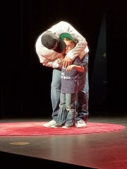 Recovering heroin addict Nathan Scheer hugs his 5-year-old son Bentley on stage at the Aug. 25 Tedx talk, held in Fond du Lac. The duo received the only standing ovation of the evening.