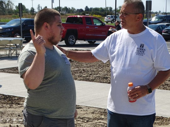 Terra State Community College Interim President Ron Schumacher, right, talks with student Gavin Sturgill Friday as students move into the new Landings at Terra Village. The student housing facility is only the second on-campus residence hall at an Ohio community college.