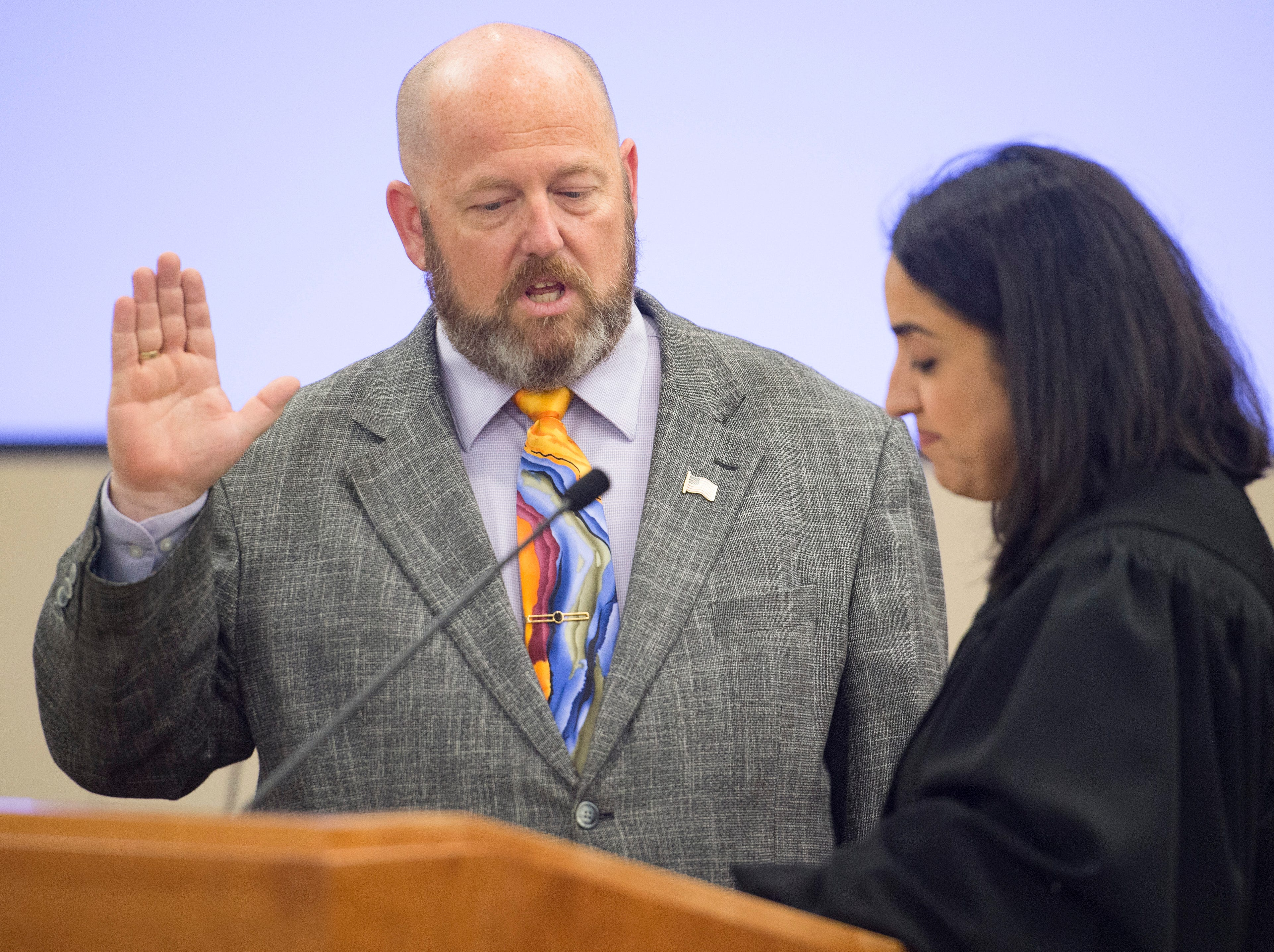 Sean Dougherty is sworn in as Larimer County Commissioner by Judge Susan Blanco on Friday, September 28, 2018. Dougherty was appointed to the position in the vacancy left by Lew Gaiter III after his death on September 18.