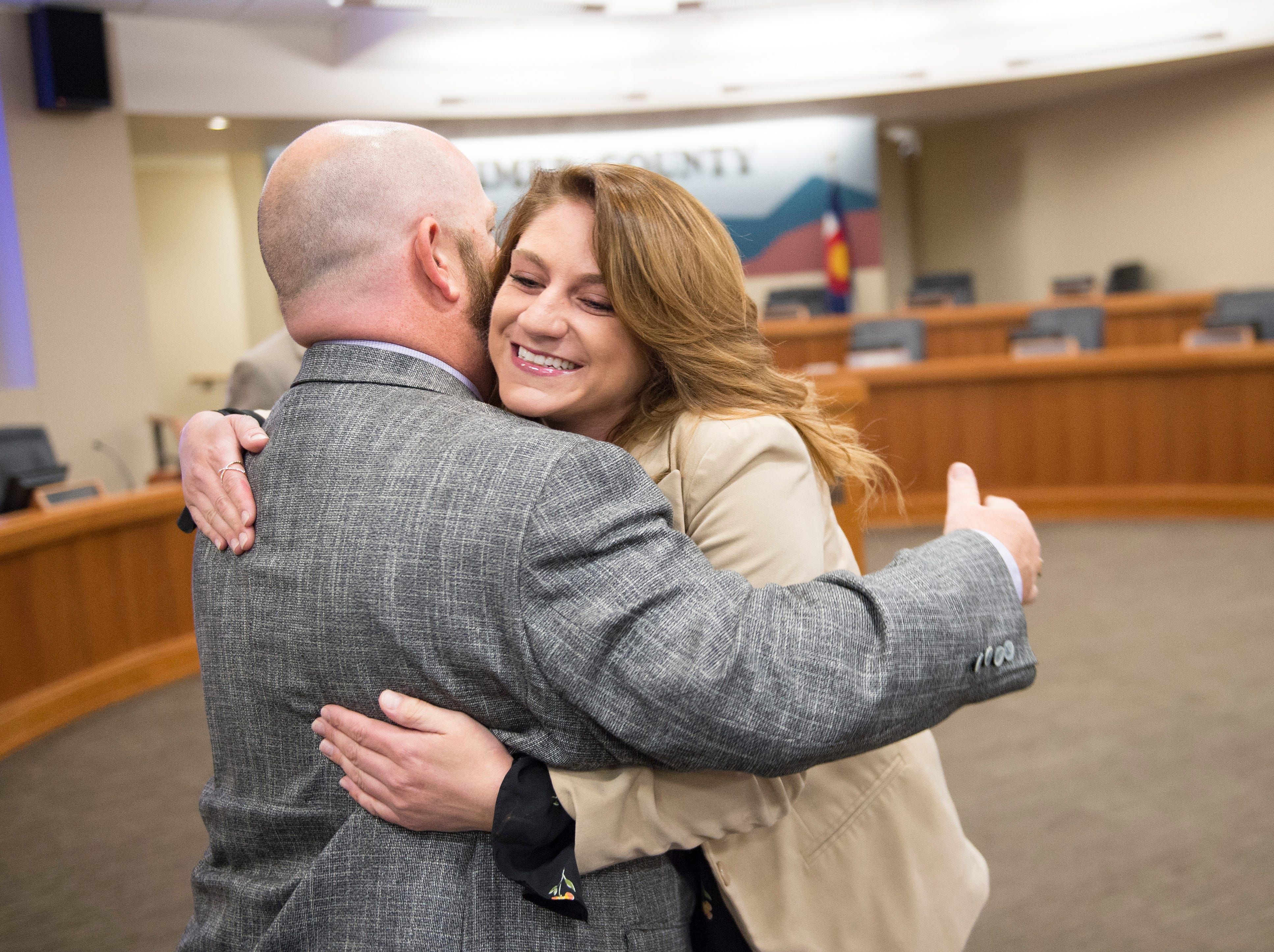 Sean Dougherty hugs his campaign manager, Mackenzie Davin before he is sworn in as Larimer County Commissioner on Friday, September 28, 2018. Dougherty, running for the District 1 seat of the commission,  was appointed to the position in the vacancy left by Lew Gaiter III after his death on September 18.