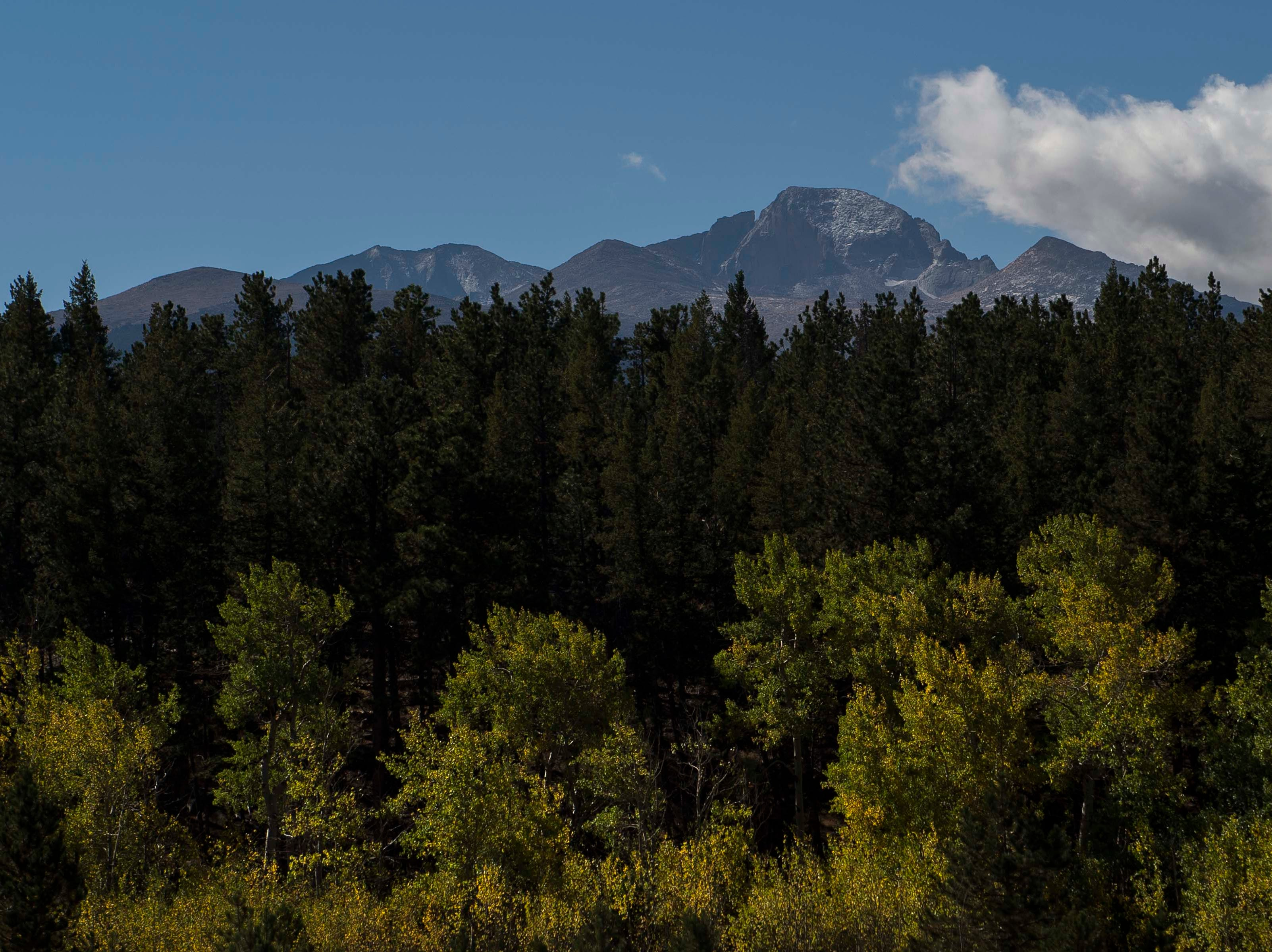 Clouds roll over Longs Peak on Monday, Sept. 24, 2018, at Rocky Mountain National Park in Colo.