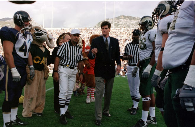 Commissioner Craig Thompson tosses the coin before the Mountain West's first football game on Sept. 16, 1999, between CSU and BYU. The Cougars won the game, played in Provo, Utah, 34-13.