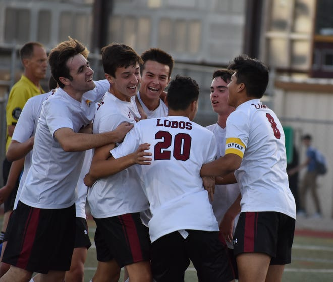 Rocky Mountain High School soccer players celebrate a goal during a game last season against Poudre. The Lobos host Windsor at 6:15 p.m. Wednesday at French Field.