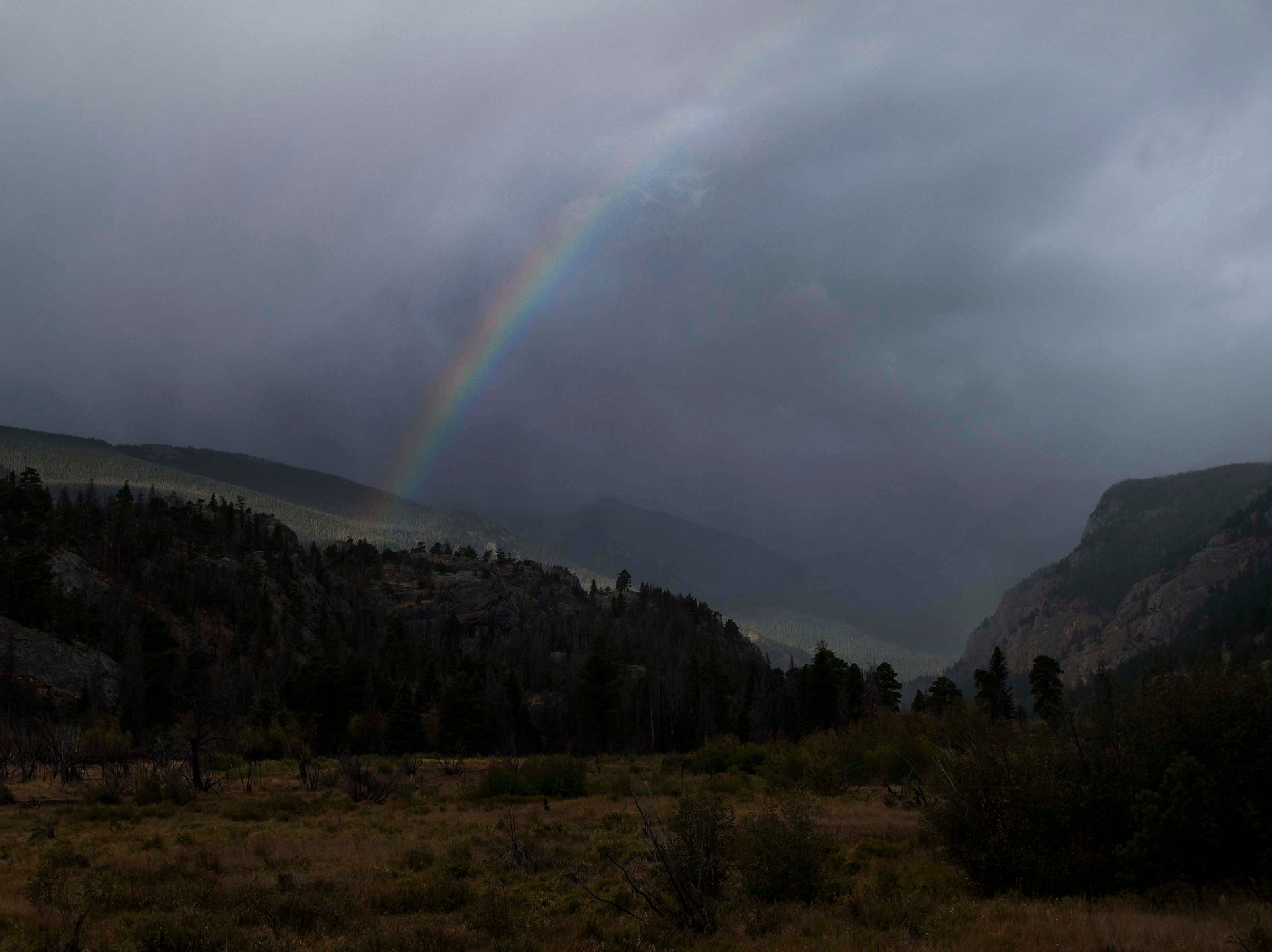 A rainbow forms in a morning rain shower near Moraine Park on Monday, Sept. 24, 2018, at Rocky Mountain National Park in Colo.