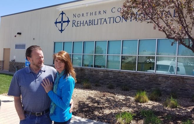 Shelly Walter, a nurse who contracted the flu and experienced severe complications, is pictured outside the Northern Colorado Rehabilitation Hospital with her husband.