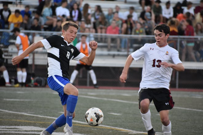 Poudre High School boys soccer player Keegan Seidl tries to work the ball past Rocky Mountain's Timmy Thompson during a match Thursday. Both teams are playing home games Tuesday, with Poudre facing Horizon at 6 p.m. at Fossil Ridge, and Rocky Mountain taking on Mountain Range at 6 p.m. at French Field in the second game of a doubleheader. Fort Collins is playing Fairview at French Field at 4 p.m.