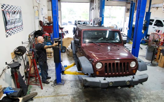 The Jeep belonging to fallen Fort Myers Police officer Adam Jobbers-Miller is being made over by volunteers as part of Savage 4x4 Inc's., Hero Project, in Fort Myers. The project honors Jobbers-Miller and other fallen law enforcement officers.