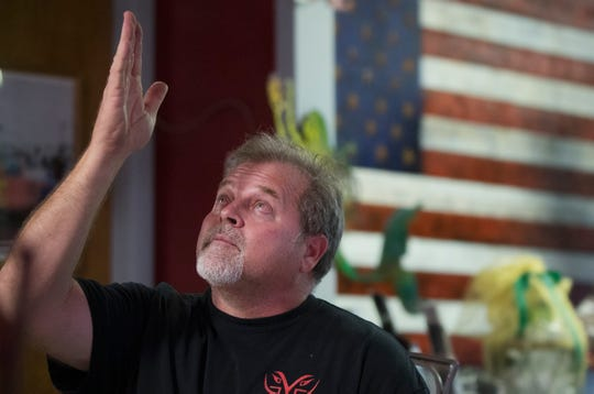 """""""We're doing it for him,"""" says Jim Thompson, of making over the Jeep belonging to fallen Fort Myers Police officer Adam Jobbers-Miller on Thursday at Savage 4x4 Inc., in Fort Myers. Thompson, owner of Savage, is leading volunteers in the Hero Project that honors Jobbers-Miller and other fallen law enforcement officers."""