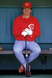 Pete Rose sits in the dugout