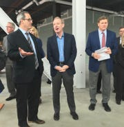 Microsoft President Brad Smith (center) talks with Brown County Executive Troy Streckenbach in the unfinished TitletownTech building in Ashwaubenon on Sept. 19, 2018.