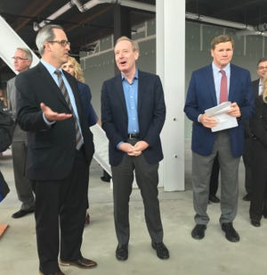 Brown County Executive Troy Streckenbach, left, speaks with Microsoft President Brad Smith in the unfinished TitletownTech building in Ashwaubenon on Sept. 19, 2018. Green Bay Packers President Mark Murphy is at right.