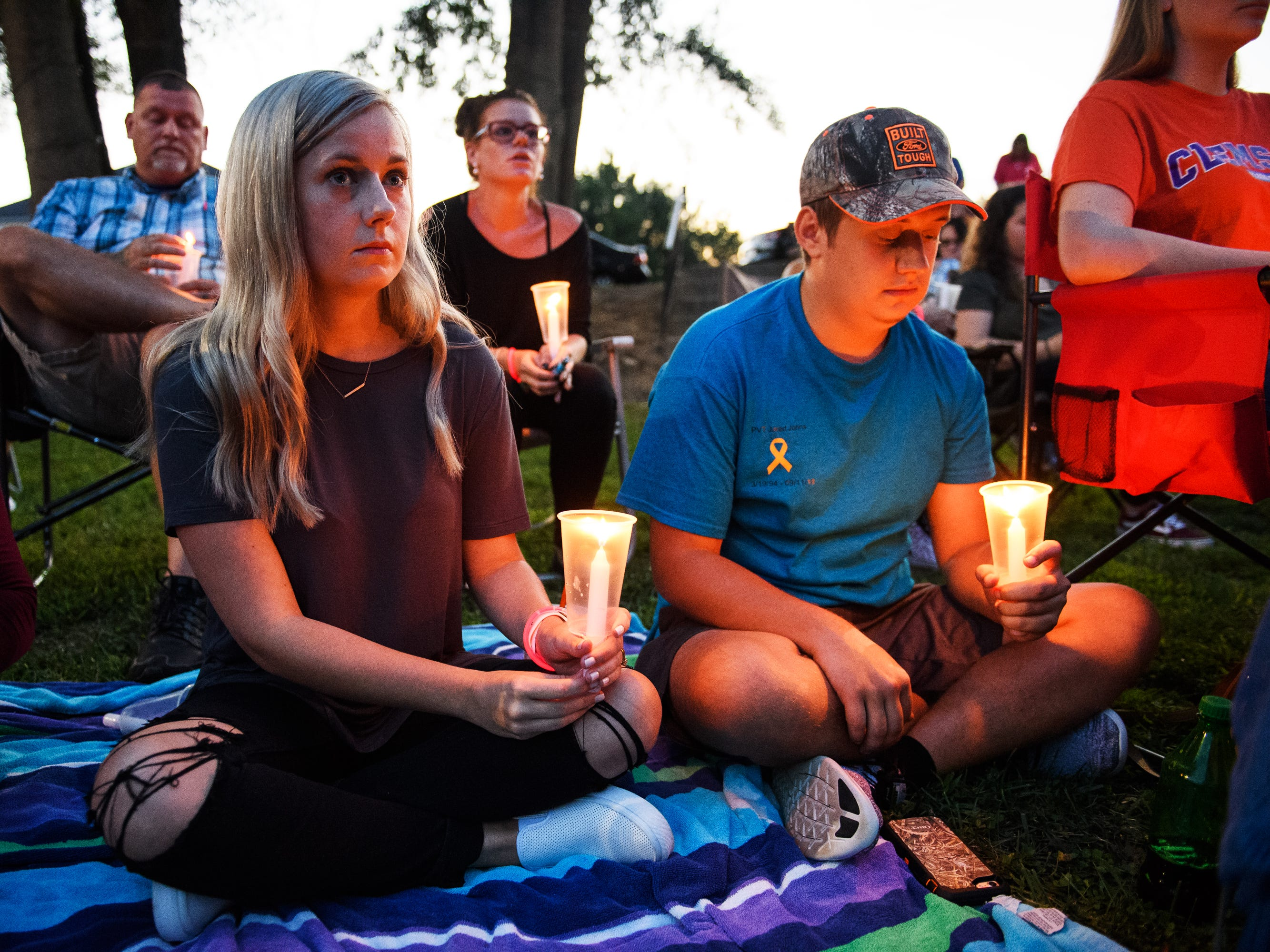 Tiffany Hale and Brandon Keith attend a candlelight vigil in honor of Jared Johns at Simpsonville City Park on Sunday, Sept. 23, 2018.