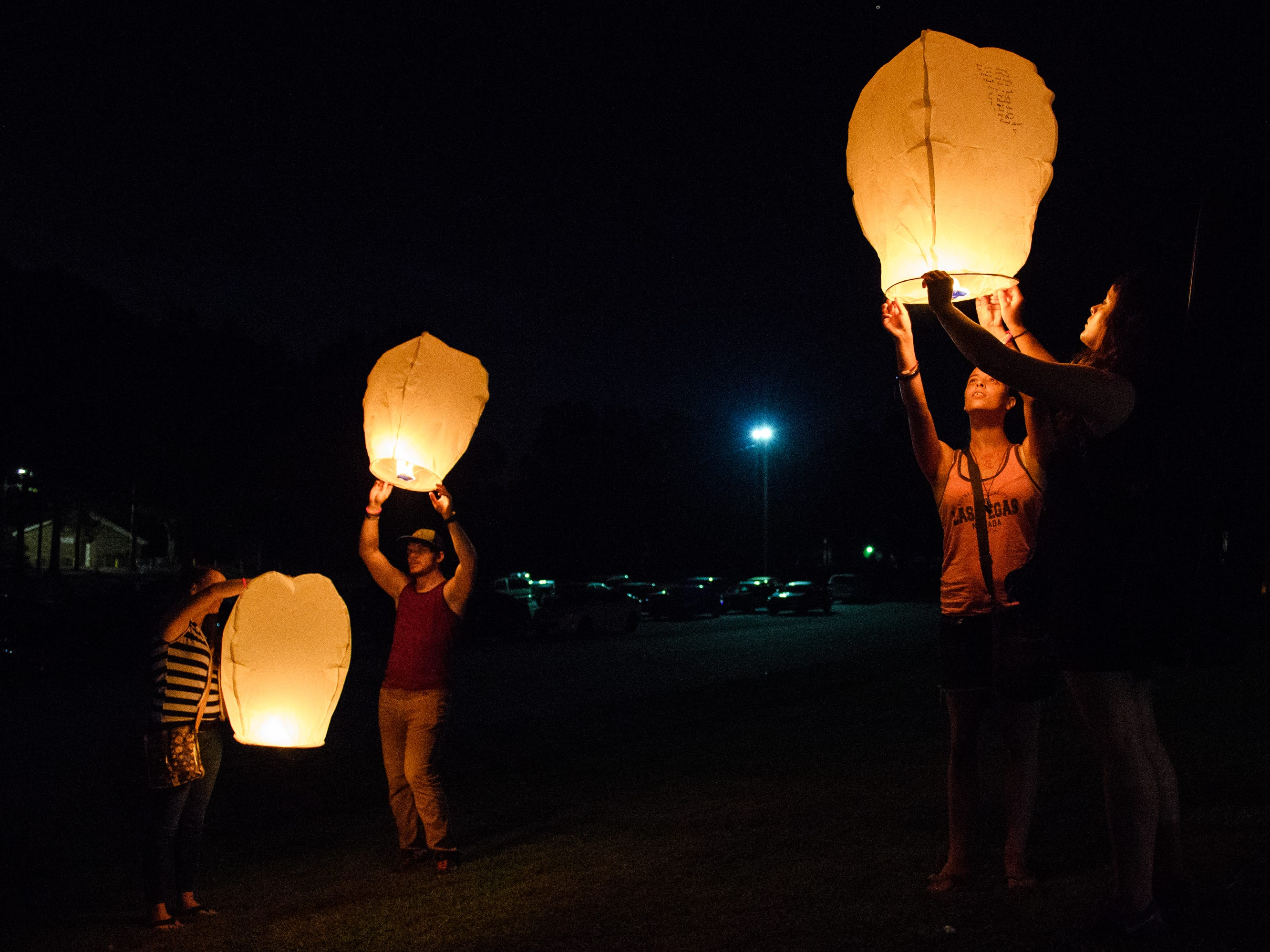 Family and loved ones of Jared Johns release paper lanterns into the air during a vigil honoring his life at Simpsonville City Park on Sunday, Sept. 23, 2018.
