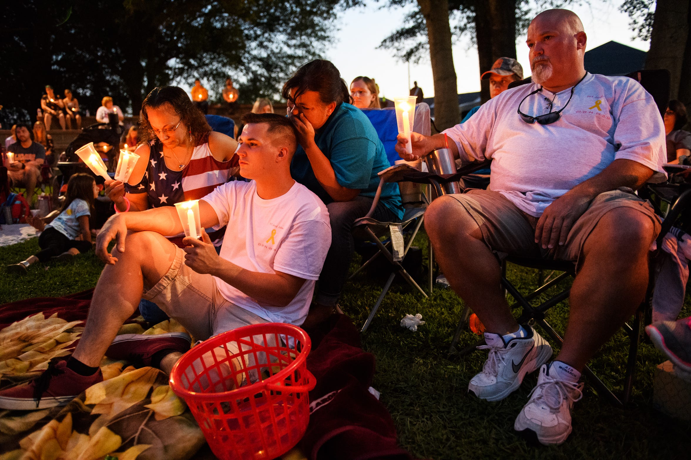 Family and loved ones of Jared Johns participate in a candlelight vigil honoring his life at Simpsonville City Park on Sunday, Sept. 23, 2018.