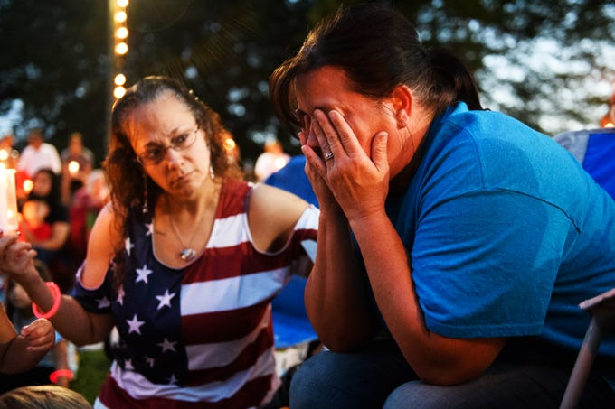 Lisa Jules comforts Kathy Bowling during a candlelight vigil in honor of Bowling's son, Jared Johns, at Simpsonville City Park on Sunday, Sept. 23, 2018. Jared Johns, a U.S. Army veteran who suffered from depression due to PTSD, committed suicide on Tuesday, Sept. 11, 2018.