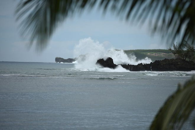 Rough waters hit rocks in Agat on Sept. 28, 2018