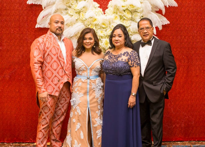 Norman and Hernalin Analista and Ana Mae and Lito Gatuz recently attended the Red Ball at the Dusit Thani Guam Resort on Sept. 22. The contrast in the couple's clothing styles show how individuals can express themselves through clothing without saying a word.