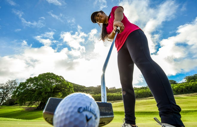 Guam's best female golfer, Nalathai Vongjalorn, addresses the ball with her putter while at the Country Club of the Pacific in Ipan, Talofofo on Friday, Sept. 28, 2018.