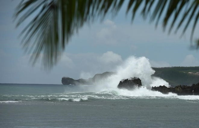 Rough waters hit rocks in Agat on Sept. 28. A high-surf advisory will likely be in effect for Guam over the coming week as Tropical Storm 30W continues westward away from the island.