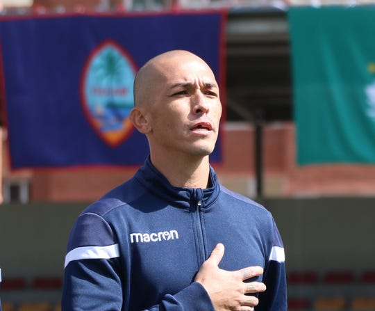 """Jason Cunliffe is shown singing """"The Guam Hymn"""" before the Matao's match against Macau in the EAFF E-1 Football Championship Preliminary Competition Round 1 tournament earlier this month in Ulaanbaatar, Mongolia."""