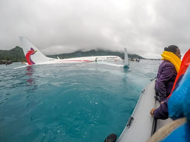 U.S. Navy Sailors from Underwater Construction Team 2 assist local authorities in shuttling the passengers and crew of Air Niugini flight to shore following the plane crashing into the sea on its approach to Chuuk International Airport in the Federated States of Micronesia.