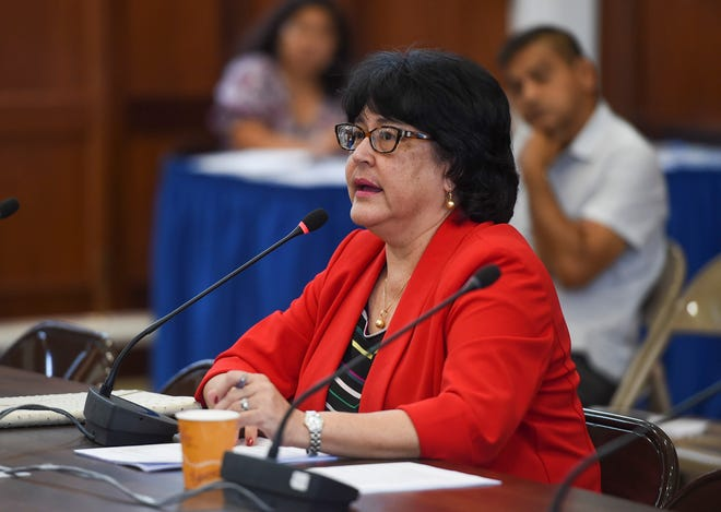 Attorney General Elizabeth Barrett-Anderson meets with members of the 34th Guam Legislature to discuss the island's political status plebiscite and an update on gambling machine licenses at the Guam Congress Building in Hagåtña, Sept. 28, 2018.