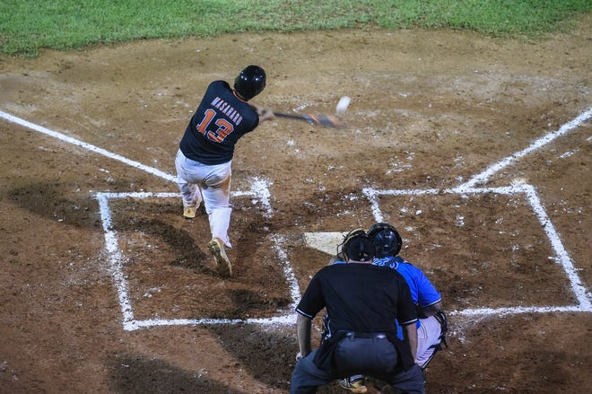 Orioles center fielder Poland Masaharu connects on a pitch against the IT&E Rays during Game 5 of the Guam Major League Baseball Championship series at Paseo Stadium on Sept. 28. The game was suspended due to wet field conditions with the Rays leading 11-4. A new Game 5 is set for 7 p.m. Oct. 5.