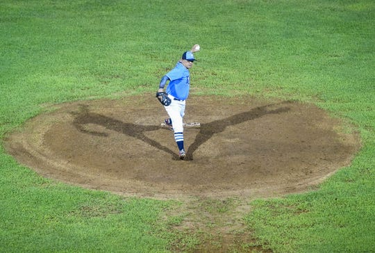 IT&E Rays pitcher Paul Pangelinan winds up at the mound against the Orioles during game five of their Guam Major League Baseball Championship series at Paseo Stadium on Sept. 28, 2018.