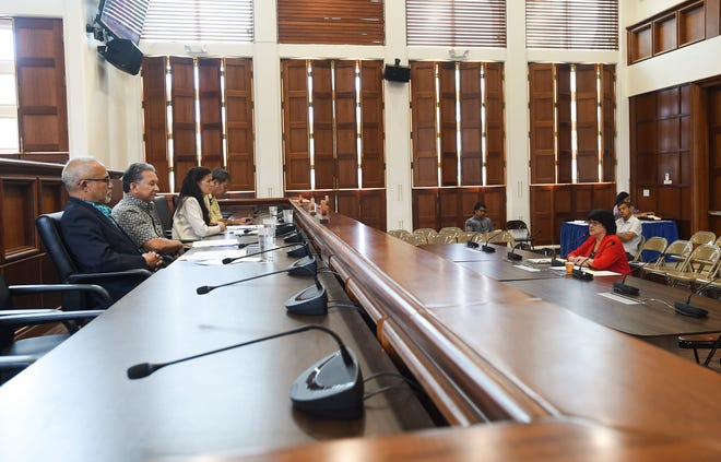 In this Sept. 28 file photo, Attorney General Elizabeth Barrett-Anderson meets with members of the 34th Guam Legislature to discuss the island's political status plebiscite at the Guam Congress Building in Hagåtña.