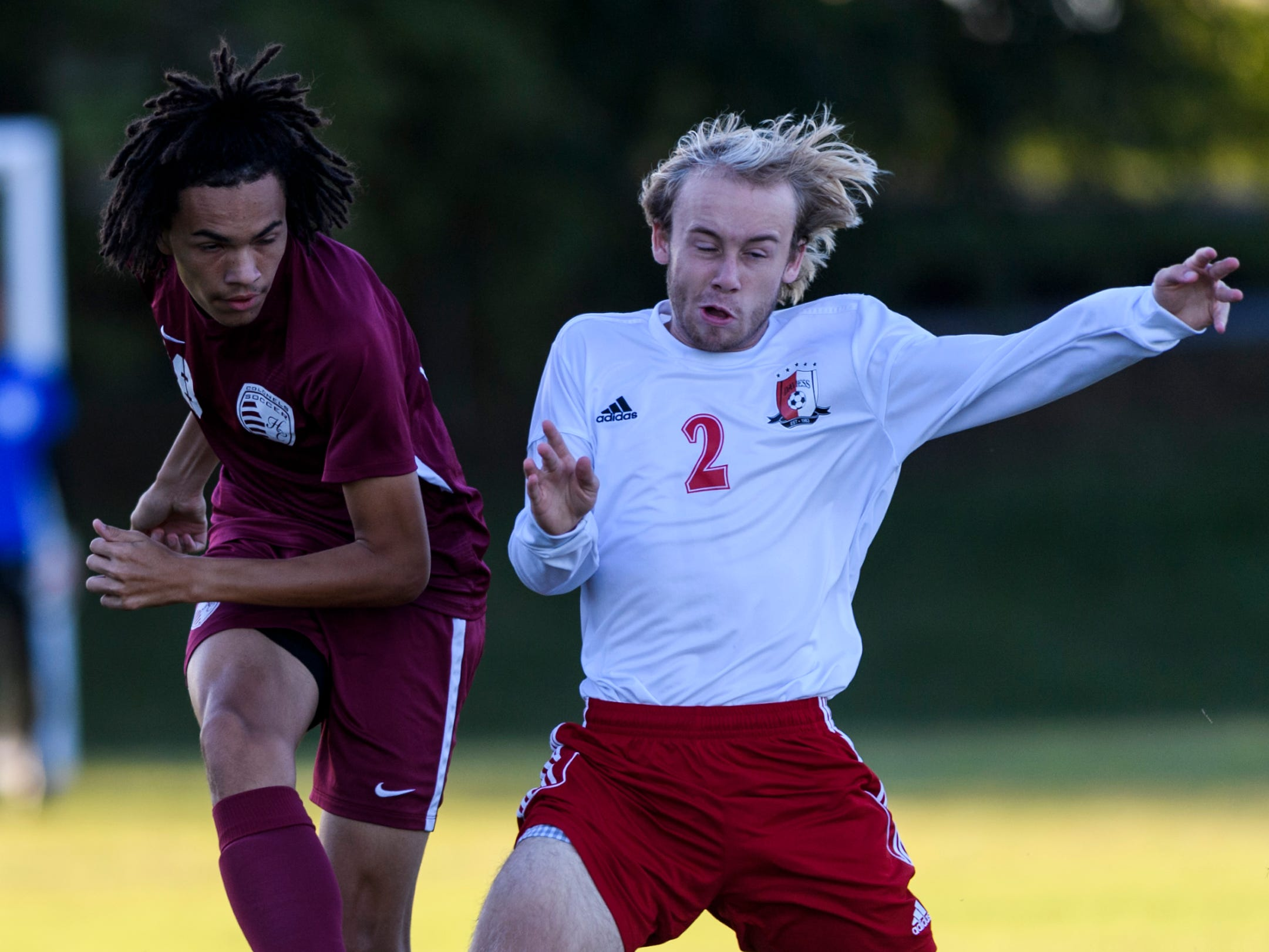 Daviess County's Hunter Clark (2) keeps the ball from Henderson County's Andre Cruce (18) at Colonel Field in Henderson, Ky., Thursday, Sept. 27, 2018. The Panthers defeated the Colonels 5-3.