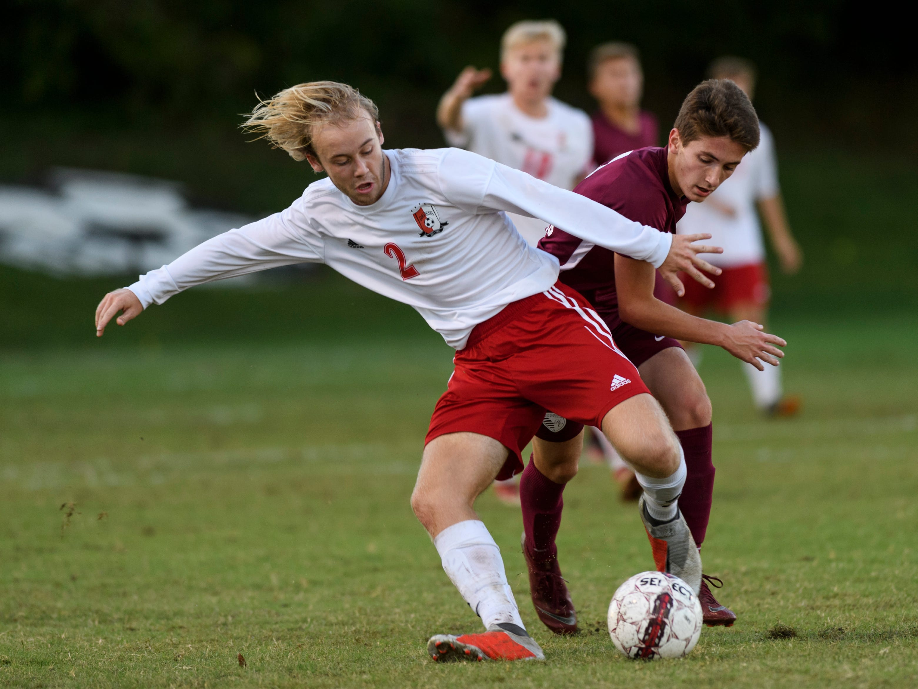 Daviess County's Hunter Clark (2) keeps the ball from Henderson County's Samuel Cloutier (2) at Colonel Field in Henderson, Ky., Thursday, Sept. 27, 2018. The Panthers defeated the Colonels 5-3.