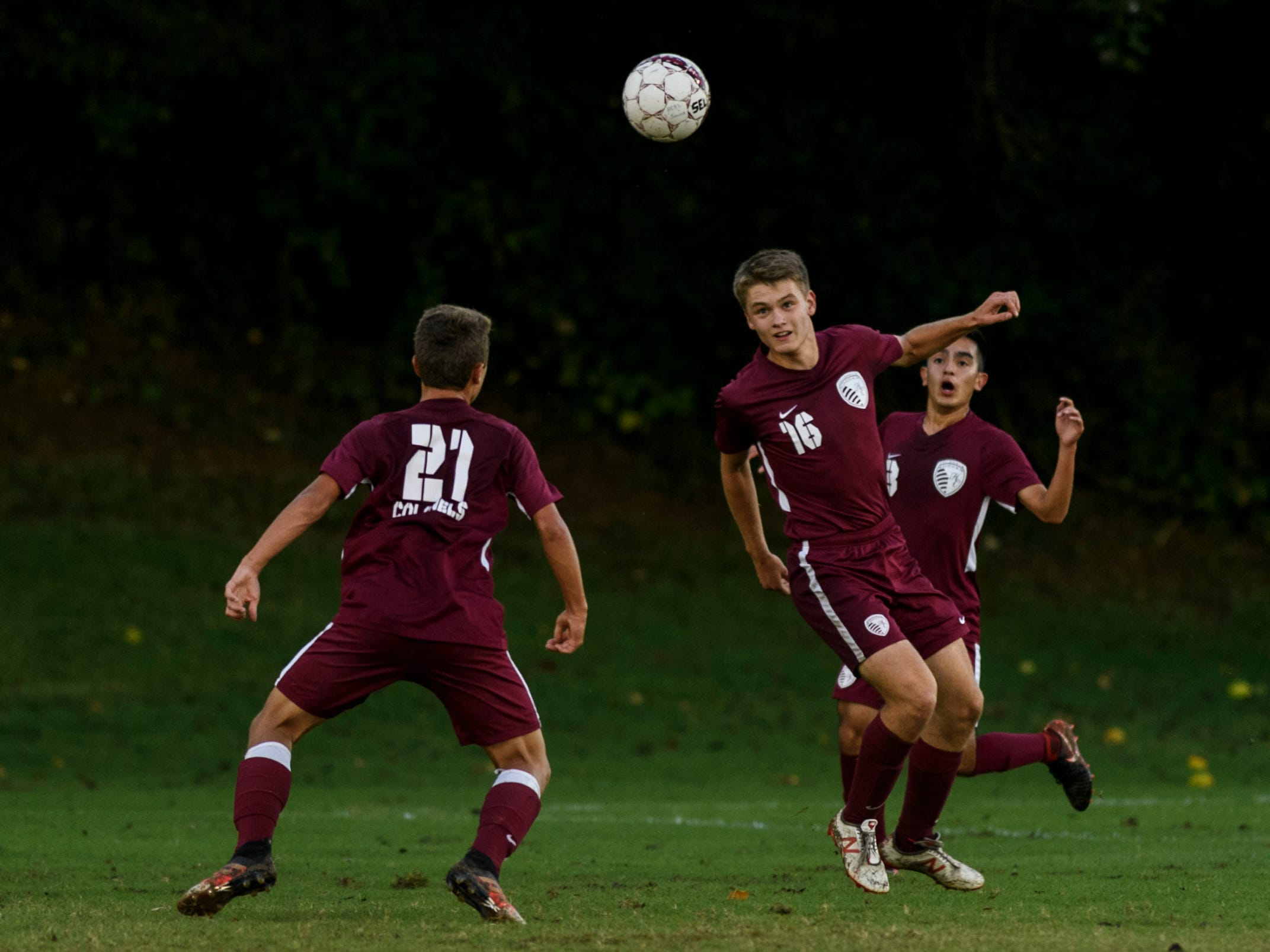 Henderson County's Lucas Butler (16) heads the ball to teammate Ashton Todd (21) during the match against the Daviess County Panthers at Colonel Field in Henderson, Ky., Thursday, Sept. 27, 2018. The Panthers defeated the Colonels 5-3.
