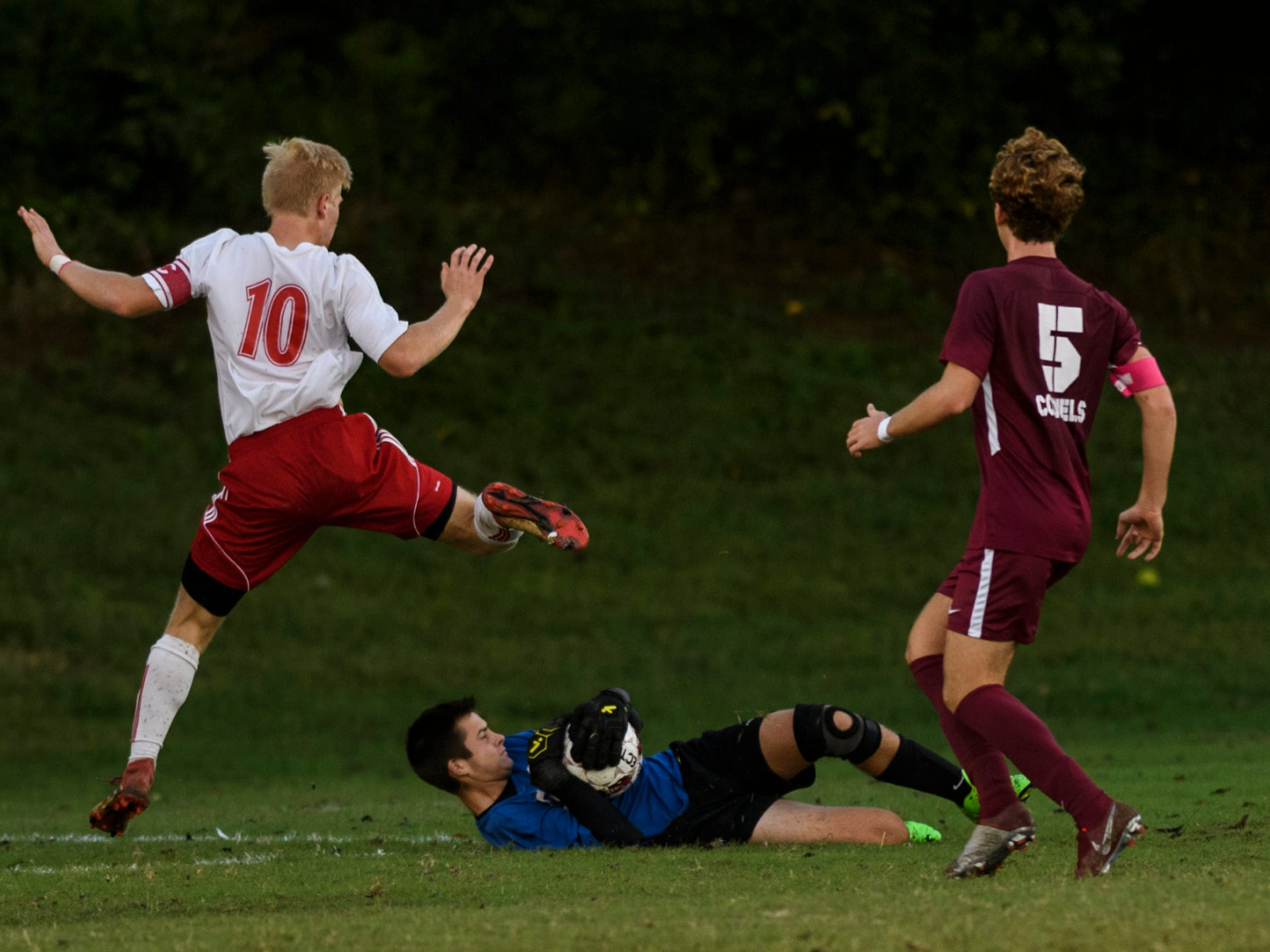 Henderson County's Adam Beickman (0) stops Daviess County's Brian Winkler (10) from advancing to the net during the match at Colonel Field in Henderson, Ky., Thursday, Sept. 27, 2018. The Panthers defeated the Colonels 5-3.