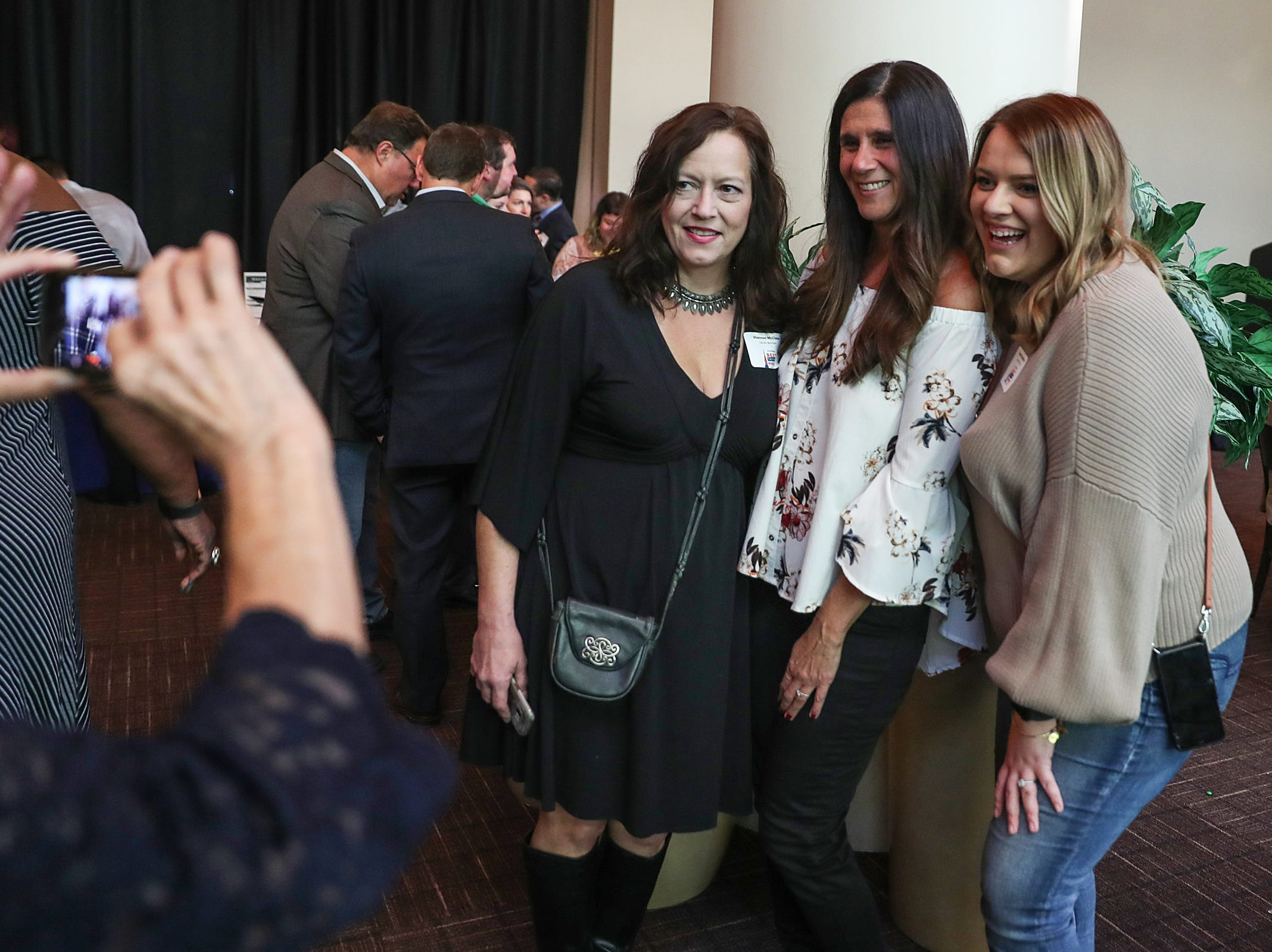 Pamela Moosey celebrates her win for Lola Blu Boutique with loved ones during the inaugural Best Things Indy 2018 award ceremony, held by IndyStar at One America Tower in Indianapolis, Thursday, Sept. 27, 2018.