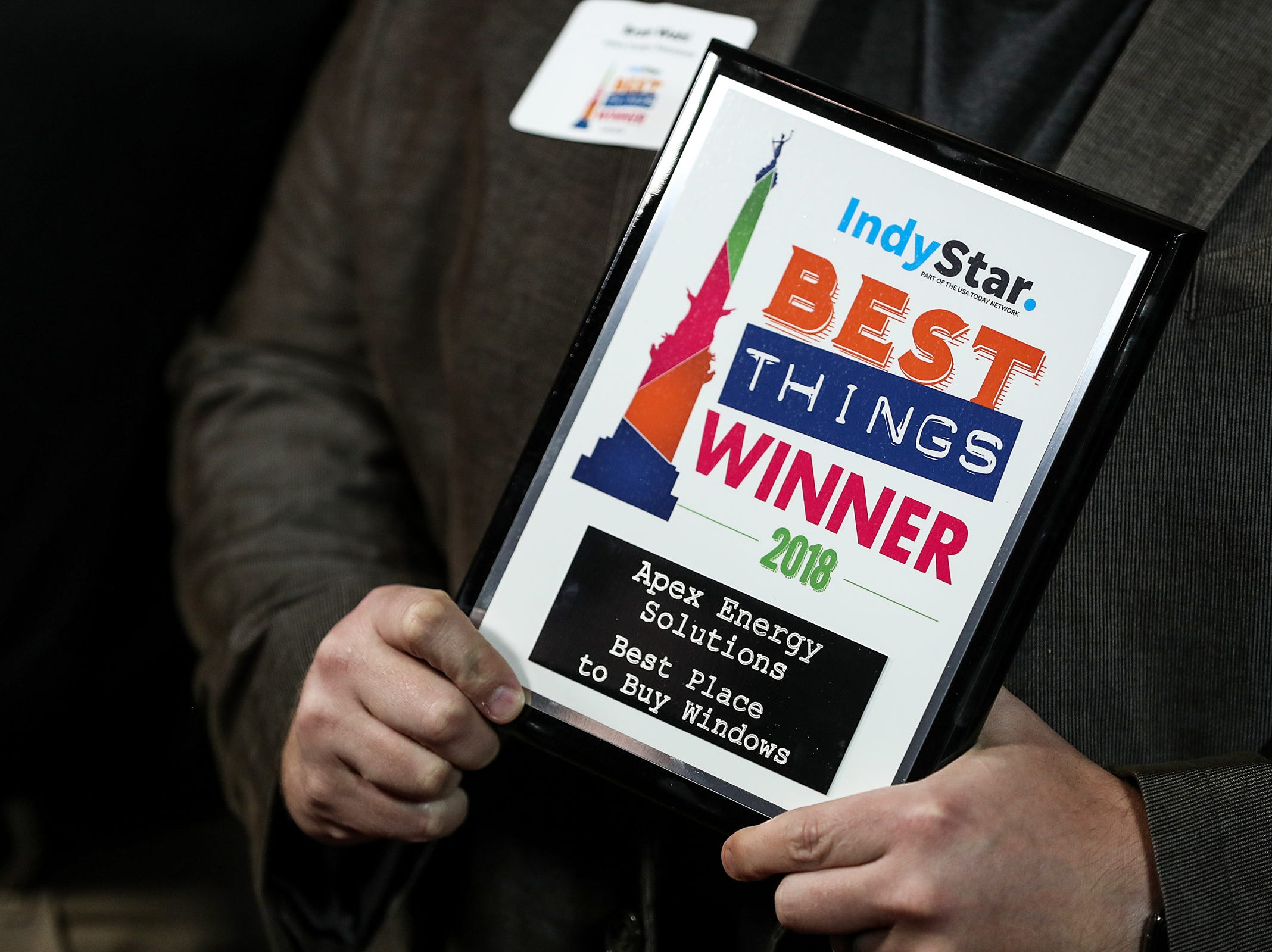 Apex Energy Solutions celebrates the win for best place to buy windows during the inaugural Best Things Indy 2018 award ceremony, held by IndyStar at One America Tower in Indianapolis, Thursday, Sept. 27, 2018.