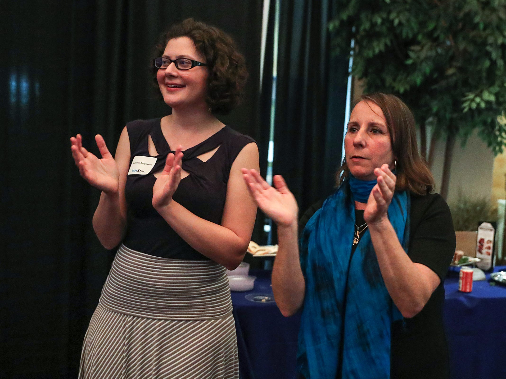 From left, IndyStar arts reporter Domenica Bongiovanni and food writer Liz Biro clap for winners during the inaugural Best Things Indy 2018 award ceremony, held by IndyStar at One America Tower in Indianapolis, Thursday, Sept. 27, 2018.