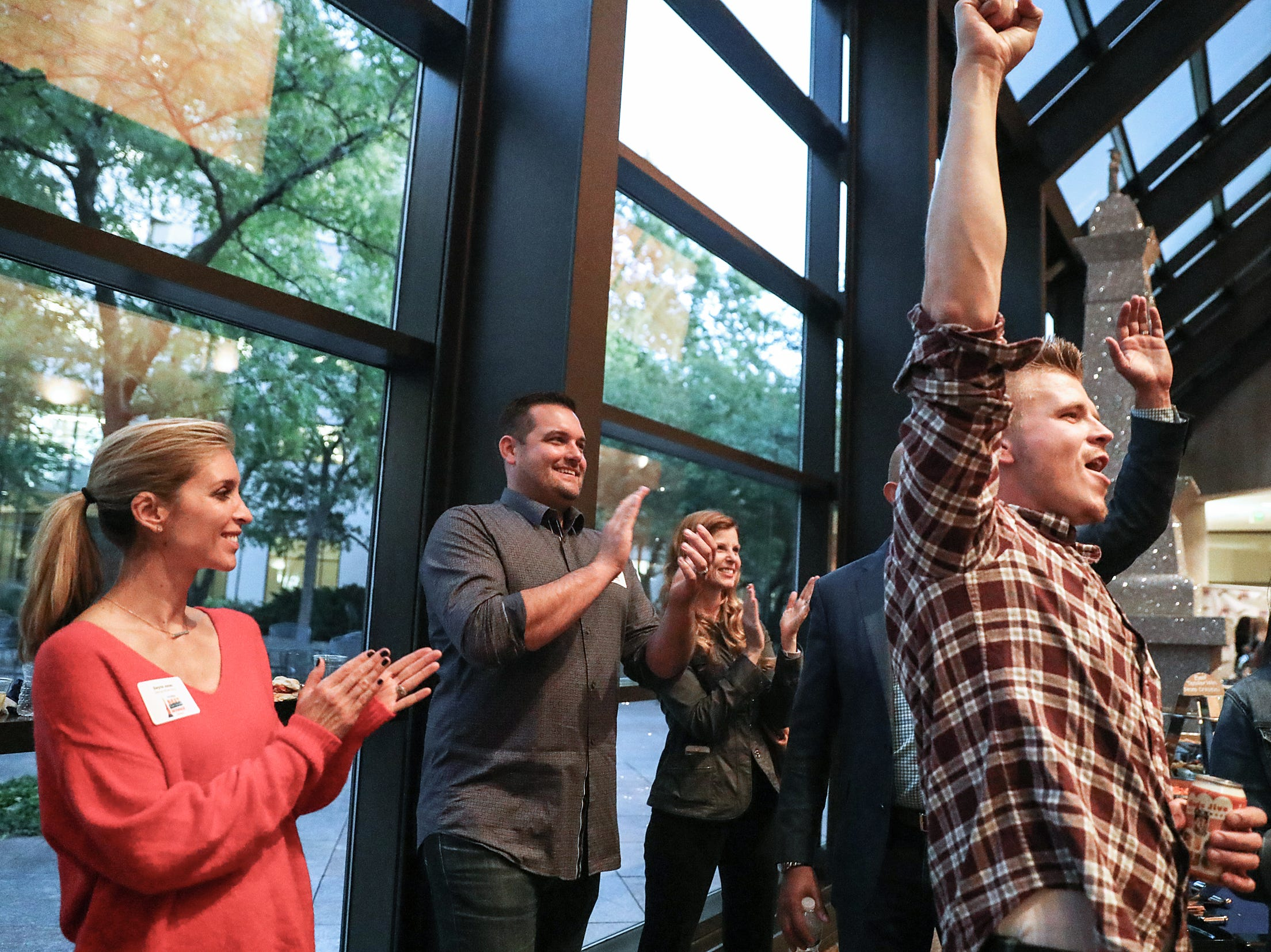 Second from left, Justin Jones and other employees, family and friends cheer as Georgia Street Grind is announced as winner for best local coffee shop during the inaugural Best Things Indy 2018 award ceremony, held by IndyStar at One America Tower in Indianapolis, Thursday, Sept. 27, 2018.