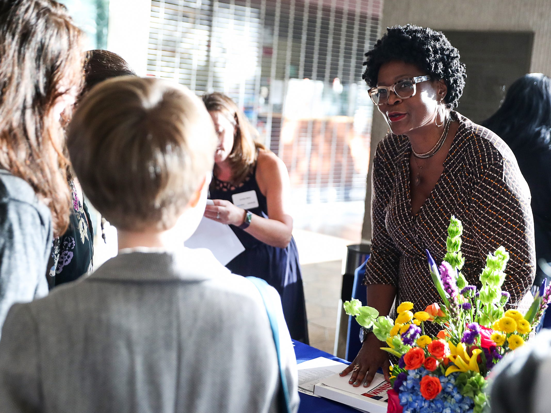 IndyStar Director of Opinion & Community Engagement Suzette Hackney checks in guests during the inaugural Best Things Indy 2018 award ceremony, held by IndyStar at One America Tower in Indianapolis, Thursday, Sept. 27, 2018.