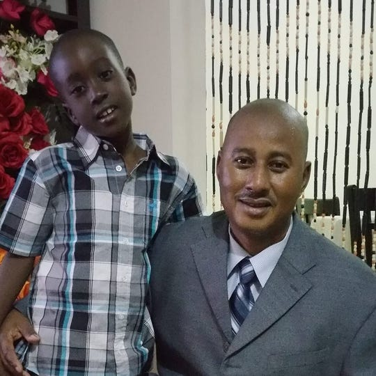 Sheriff Jallow and one of his children.