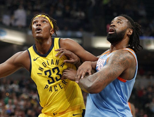 Pacers want to see better rebounding effort from Myles Turner (left).